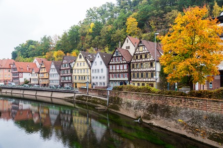 embankment: Autumn embankment of Nagold river in Calw, old German city landscape Stock Photo