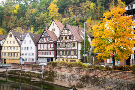 Autumn embankment of Nagold river in Calw, old German city landscape Stock Photo