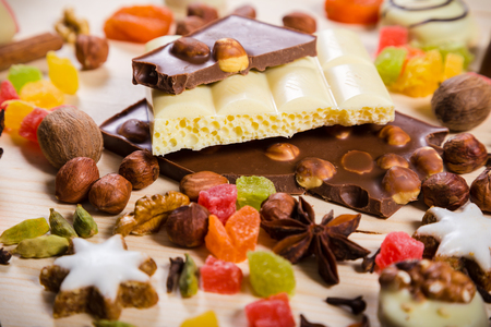 dried food: Food background with candies, nuts, cookies, chocolate, dried fruits and other sweets, selective focus Stock Photo