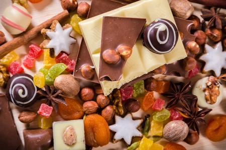 dried food: Food background with chocolate, nuts, cookies, candies, dried fruits and other sweets