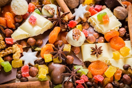 frutos secos: food background with candies, nuts, cookies, chocolate, dried fruits and other sweets