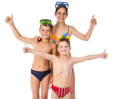 Family with three happy kids in swimsuit standing together, isolated on white Stock Photo