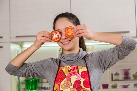 Funny girl with tomato on eyes photo