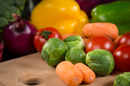 Closeup of assorted fresh vegetales on cutting board Stock Photo