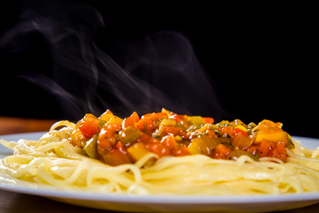 closeup of noodles in plate with vegetable sauce Stock Photo
