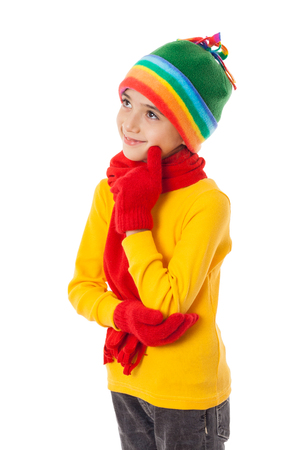 Thoughtful girl in winter clothes Stock Photo