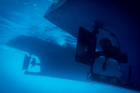Underwater view to yacht rudder and prop