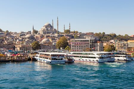 Istanbul. Turkey - 21 october 2014: passenger boats near station Eminonu on the Golden Horn bay with passengers