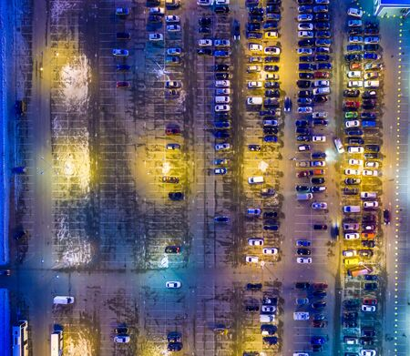 Winter evening aerial view to parking lot near supermarket
