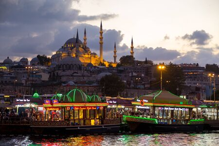 Istanbul. Turkey. Fishing boats restaurant at Golden Horn bay