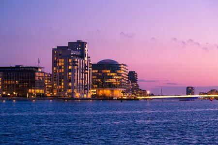 Evening view to modern buildings at Sydhavnen channel embankment on Copenhagen, Denmark