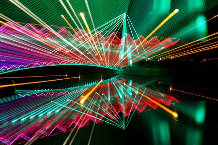 Colorful electric lights motion abstract background. City lights with long exposure