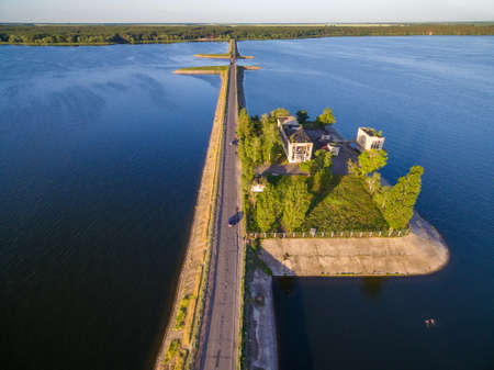Aerial panoramic view to old pumping station on dam at Severskiy Stockfoto