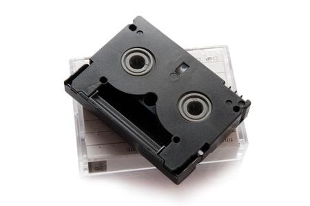 videocassette: Cinta de v�deo miniDV est�ndar aislado en un fondo blanco Foto de archivo