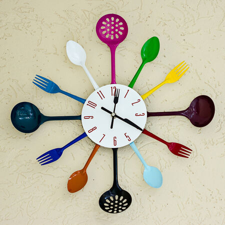 mid century modern: Kitchen abstract clock with spoons and forks.