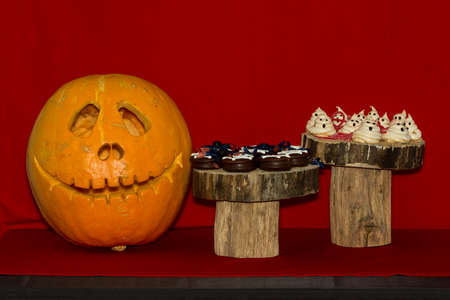 autumn food: Pumpkins on the decorated table for the halloween. Stock Photo