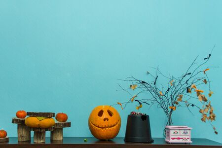 vegetable background: Pumpkins on the decorated table for the halloween. Stock Photo