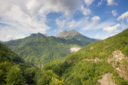 mounts: White clouds in the blue sky over the mounts. Montenegro. Stock Photo
