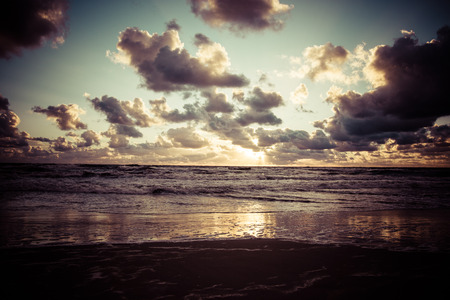 Sunset over the Baltic sea with dramatic clouds. Stock Photo