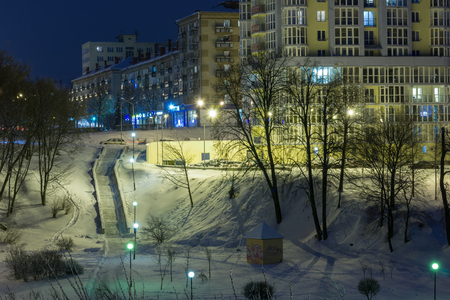 Night cityscape in winter, all covered with white snow.