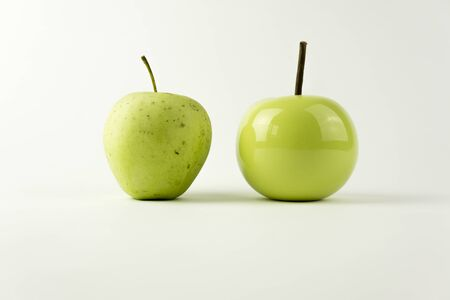 apple gmo: A natural apple versus and a ceramic apple