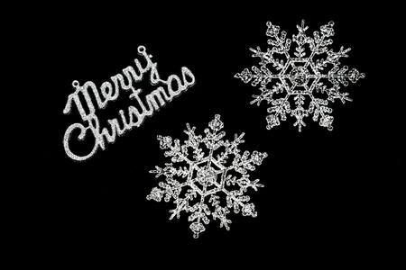 hollidays: Black merry christmas card with two giant snow flakes