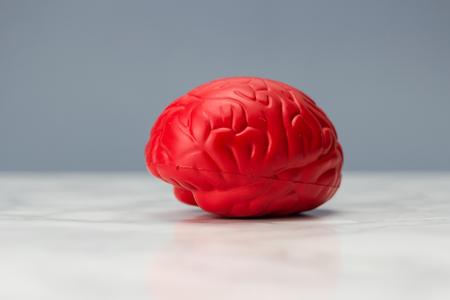 memory drugs: Red brain on dark background