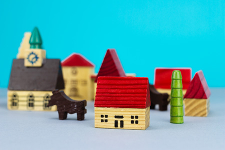 Figurine hometown on blue background Stock Photo