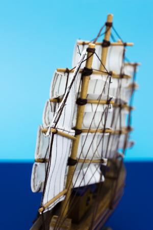 springbreak: Wooden handmade ship on blue background