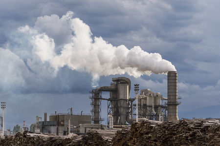 industrial scene with chimneys and stormy sky Editorial