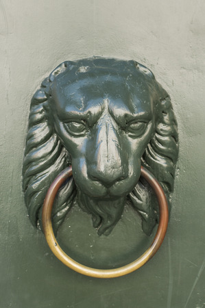 knocker in the shape of a lion, classic lion of Venice Italy photo