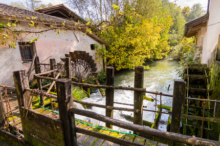 disuse: The shovels of an old water mill now in disuse