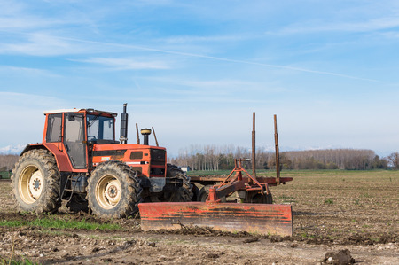 agricultural implements: Agricultural Landscape with farm implements, tractor wagon and shovel leveling