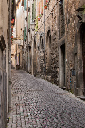 orvieto: Italy, Umbria, Orvieto: traditional Italian village alley with flowers, cobblestones, windows and picturesque steps