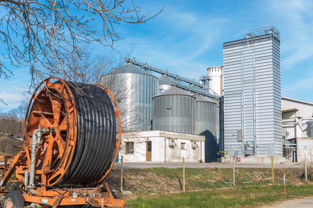 irrigator: Storage facility cereals and production of biogas; silos and drying towersand irrigator