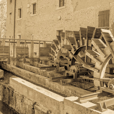 waterwheel: Effect vintage.Series of three wheeled wooden mill renovated Stock Photo