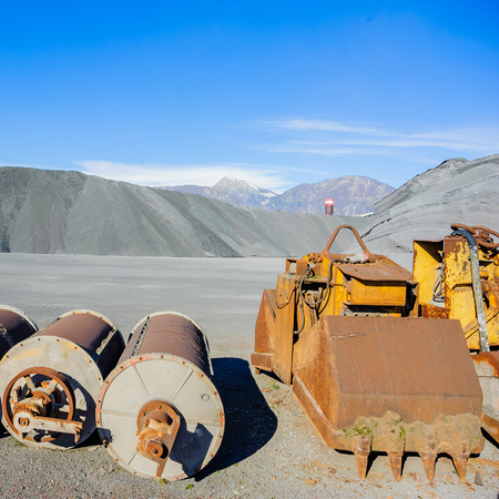 ferrous: Industrial Tools various and hill ferrous for metal foundry, the background the Alps. Stock Photo