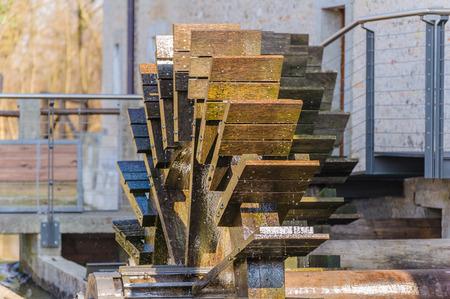 waterwheel: Series of three wheeled wooden mill renovated