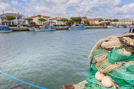 fishing floats: Fishing nets, fishing boats in the background