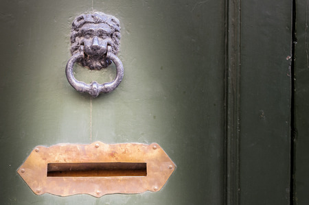 letter box: Old wooden door with knocker and letter box