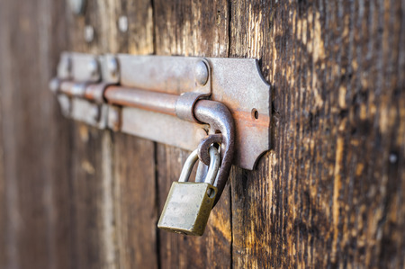 keep gate closed: Old latch of a wooden door of a cow shed Stock Photo