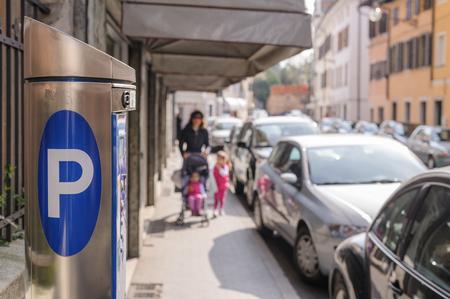 mandate: Machine parking on a city street Stock Photo
