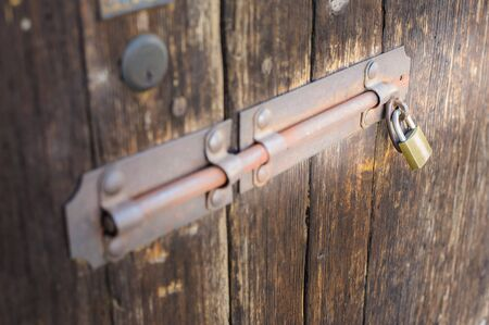 Old latch of a wooden door of a cow shed photo