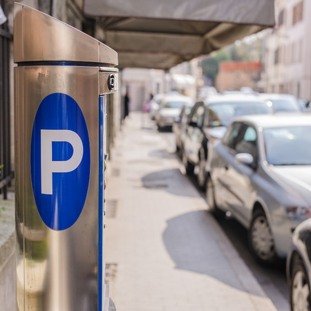 Machine parking on a city street 免版税图像