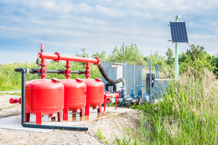 pump: System pumping water for agriculture, with the control unit powered by solar energy Stock Photo