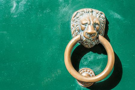 ancient lion: Ancient Lion Head Knocker Stock Photo