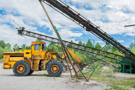 displacement: Old yellow bulldozer, for the displacement of the gravel