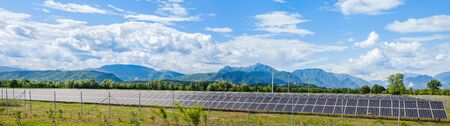 solar power station: Udine,Italy  - 24 May 2015 : Landscape with solar power station and the Italian Alps in the background Editorial