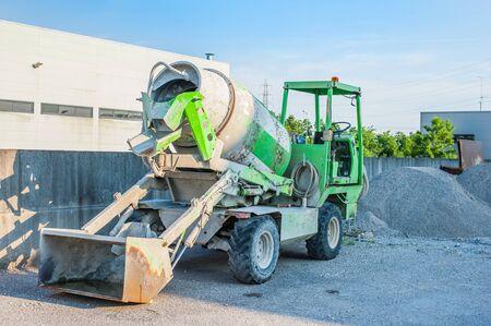 concrete mixer truck: Small concrete mixer truck at the construction site