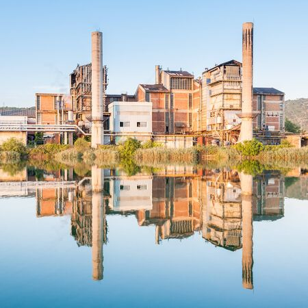 paper factory: Old paper factory that is reflected in the river